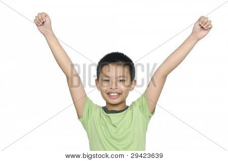 portrait of cute boy with green shirt gesturing with his arms