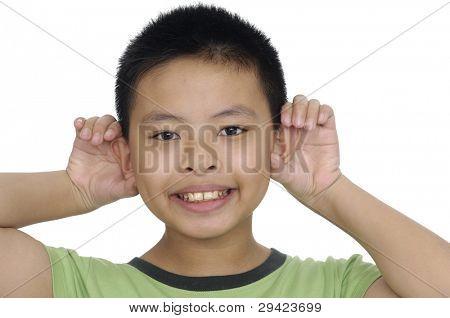 Closeup Smiling human child hand listening deaf ear gossip