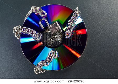 Dvd disc with unlocked chain around it for insecure data concept