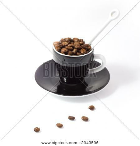 Espresso Cup And Saucer Containing Coffee Bean