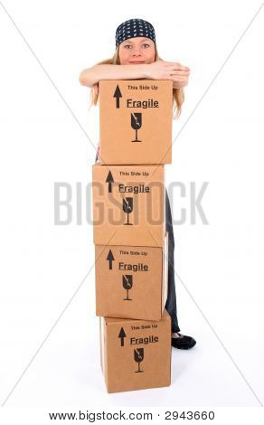 Girl With Stack Of Cardboard Boxes