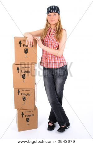 Young Woman With A Stack Of Parcels