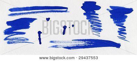 Conjunto de borrões de tinta azul
