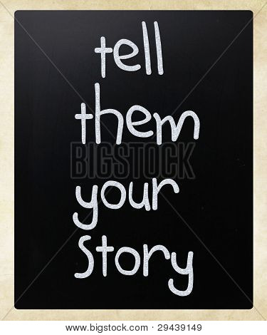 """tell Them Your Story"" Handwritten With White Chalk On A Blackboard"
