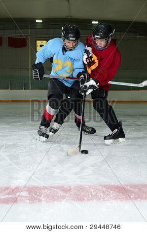 Hockey Player Scrimmage In Rink