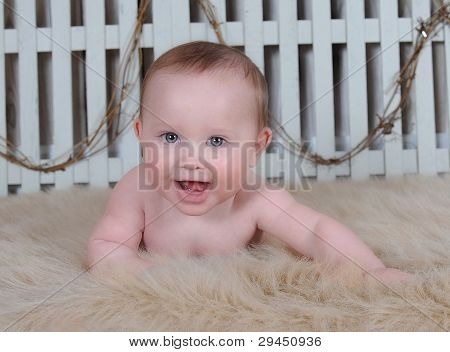 Adorable Smiling Baby Boy On Tummy On Rug