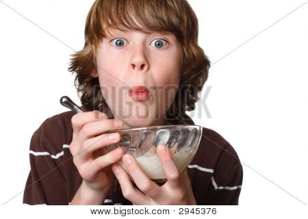 Teen Boy Eating A Bowl Of Cereal