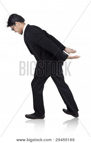 Businessman Carrying Something Heavy On His Back