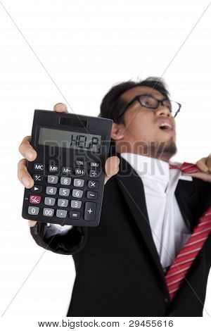 Stressed Businessman Holding A Calculator Asking For Help
