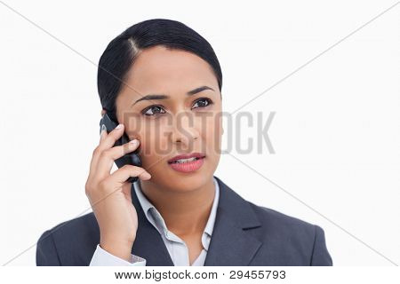 Close up of saleswoman listening to caller against a white background