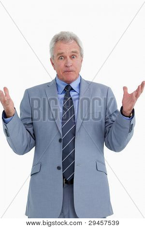 Clueless mature salesman against a white background