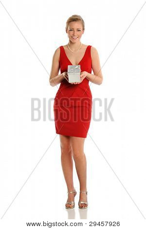 Portrait of beautiful young woman in red dress holding gift box isolated over white background