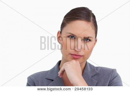 Close up of tradeswoman in thinkers pose against a white background