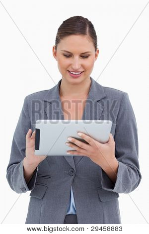 Smiling tradeswoman using her tablet computer against a white background