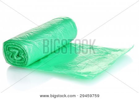 Roll of green garbage bags isolated on white