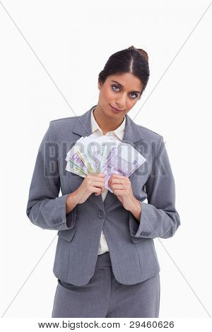 Female entrepreneur holding bank notes against a white background