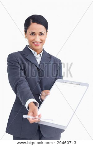 Close up of smiling saleswoman asking for signature against a white background