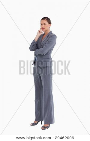 Side view of tradeswoman in thinkers pose against a white background
