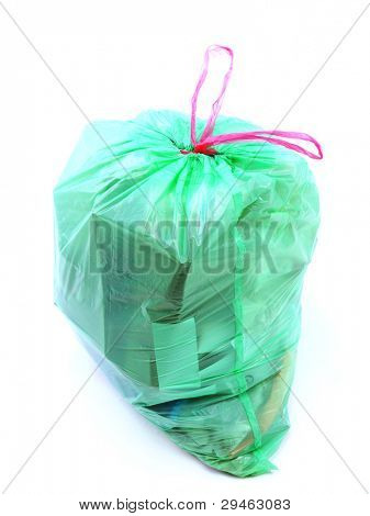 Green plastic bag full of domestic garbage shot on white background