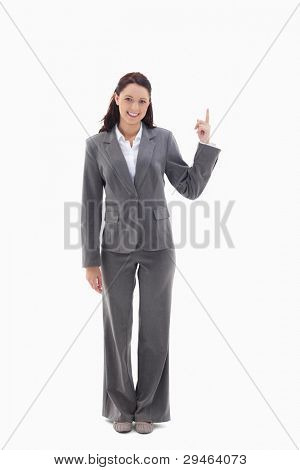 Businesswoman smiling and presenting a product on the top against white background
