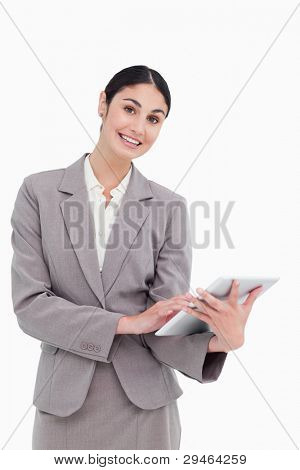 Smiling tradeswoman with her tablet computer against a white background