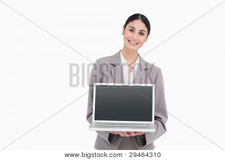 Smiling businesswoman showing screen of her notebook against a white background