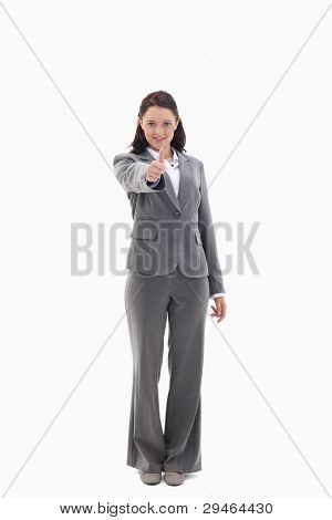 Businesswoman approving against white background