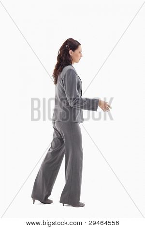Businesswoman shaking a hand against white background