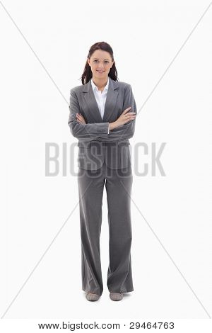 Businesswoman crossing her arms against white background