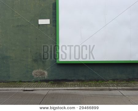 Empty Billboard On Green Grunge Wall Background