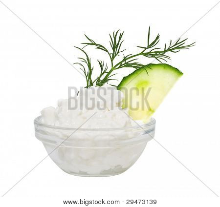 Coarse-grained cottage cheese with fennel and a cucumber. Isolated on a white background.