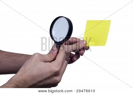 Magnifying  Glass on the Male Hand