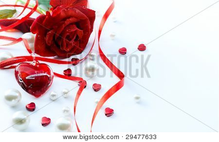 Valentines Greeting Card With Red Roses Petals And  Jewelry Heart  Isolated On White Background