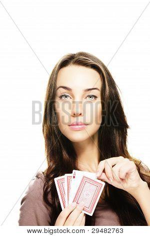 beautiful woman picking poker card