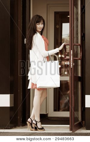 Young woman in a mall doorway