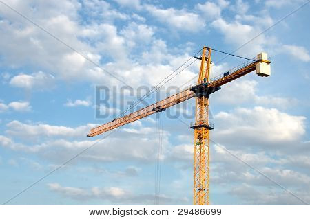 Construction Crane Against The Sky With Clouds