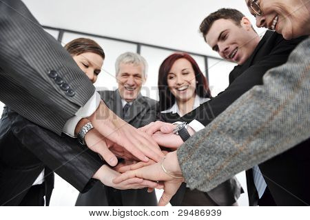 Business partners hands on top of each other symbolizing companionship and unity