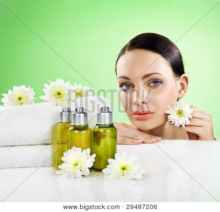 Beautiful woman and organic cosmetic. Space for text.