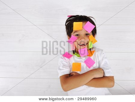 Little boy with memo posts on his face