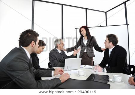 Business woman making the friendly presentation at office