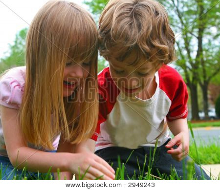 Two Children Discovering Nature