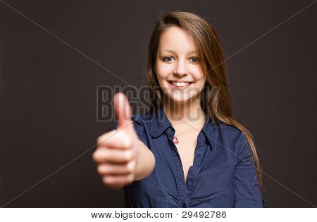 Cute Young Brunette Showing Big Thumbs Up.