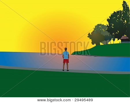 young man watching sunset on the beach