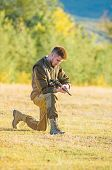 Hunting As Male Hobby And Leisure. Man Charging Hunting Rifle. Hunter Khaki Clothes Ready To Hunt Ho poster