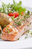 stock photo of salmon steak  - Roasted salmon steak with jacket potato - JPG