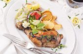 chicken leg roasted with potato and vegetable