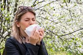 Young Woman With Allergy Symptoms, Sneezing, Blowing Her Nose, Springtime poster