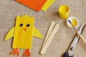 Original, Stylized Yellow Cheerful Chicken From Wooden Sticks Painted With Yellow Gouache, Scissors, poster