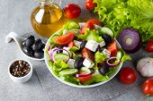 Fresh Greek Salad Made Of Cherry Tomato, Ruccola, Arugula, Feta, Olives, Cucumbers, Onion And Spices poster