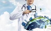 Young But Professional Man Doctor In White Sterile Suit And Stethoscope On His Neck Discovering Eart poster